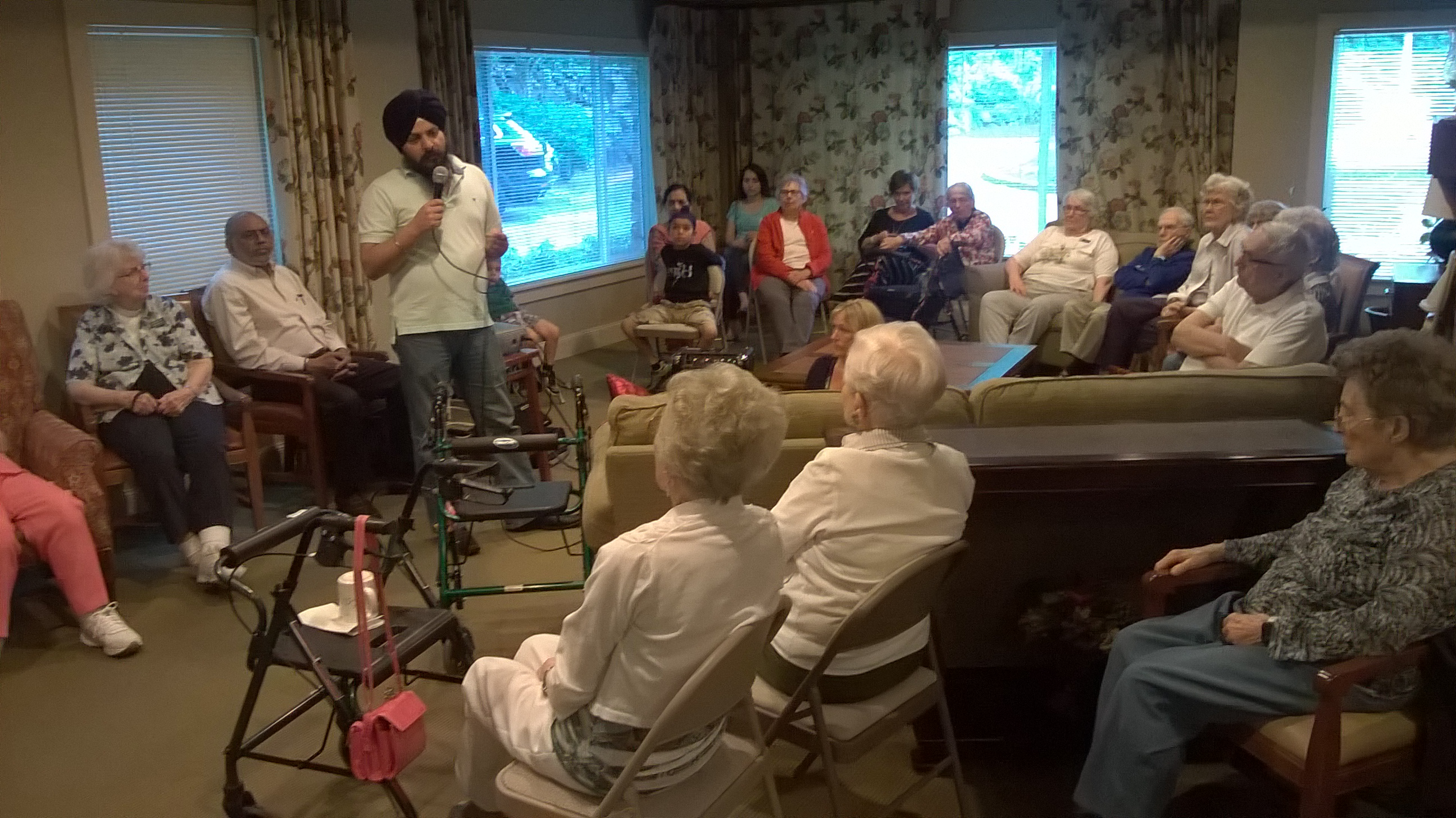 Ish From The Sikh Center Leading A Service At The Senior Home